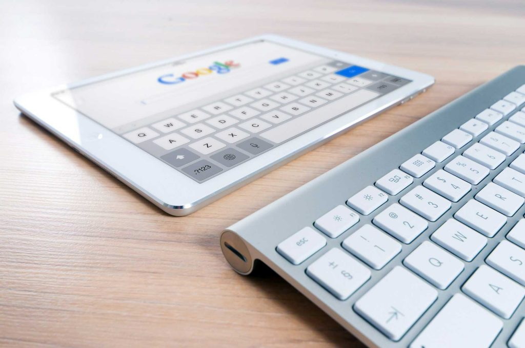 Google search on tablet with keyboard